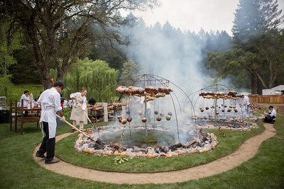 Chefs stoke the fires beneath Chef Mallmann's celebration of meat cooked over live fire. | Briana Marie Photography for Napa Valley Vintners