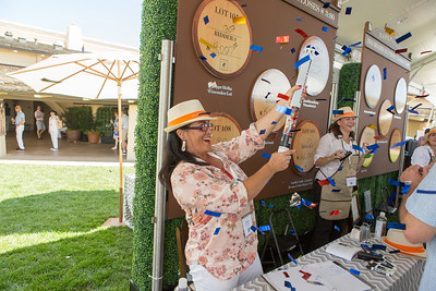 Excitement of confetti canons at the Barrel Auction. Robert Mondavi Winery  Briana Marie Photography for Napa Valley Vintners