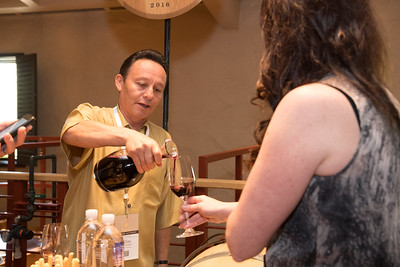 Shafer winemaker Elias Fernandez pours his wine at the barrel auction.   Photo by Bob McClenahan for the Napa Valley Vintners