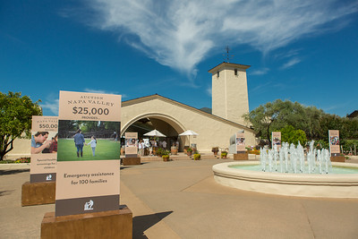 Entrance of the Barrel Auction, showing beneficiaries.  Robert Mondavi Winery  Briana Marie Photography for Napa Valley Vintners