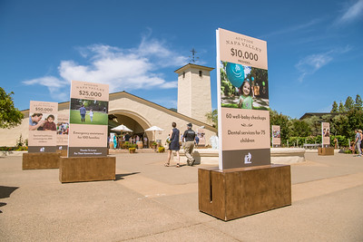 Signs showing how the proceeds of the wine auction are used in the Napa Valley community.   Photo by Bob McClenahan for the Napa Valley Vintners