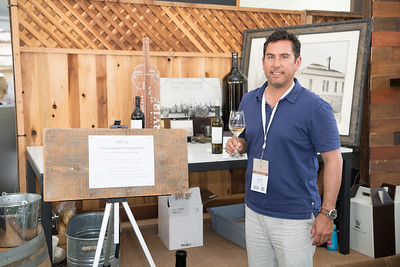 Andy Erickson in front of the Favia Erickson display.   Photo by Bob McClenahan for the Napa Valley Vintners