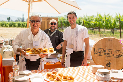 Bistro Don Giovanni whipping up delights at the Barrel Auction. Robert Mondavi Winery  Briana Marie Photography for Napa Valley Vintners