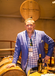 Jason Moore proudly presenting his barrel  Photo by Jon McPherson for Napa Valley Vintners
