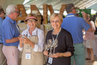Diane Dillon volunteering her time greeting guests with Mondavi Chardonnay at the Barrel Auction.  Briana Marie Photography for Napa Valley Vintners