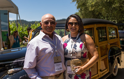 Guests enjoying the classic car  Photo by Jon McPherson for Napa Valley Vintners
