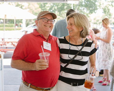 Auctioneer Fritz Hatton shares a laugh with Spotteswood's Beth Novak at Auction Napa Valley Kick-off Celebration.  Briana Marie Photography for Napa Valley Vintners.