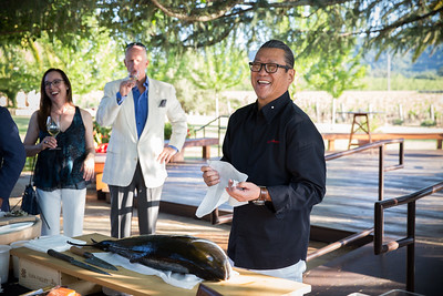 Ironchef Masaharu Morimoto jokes with guests before carving up a fresh yellowtail tuna flown in just for the dinner at Grgich Hills. Photo ©2017 by Jason Tinacci / Napa Valley Vintners