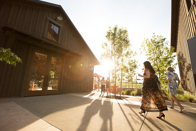 Guests walk back to the Wheeler Farm Hospitality House after a tour of the new winery. Photo ©2017 by Jason Tinacci / Napa Valley Vintners