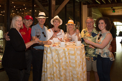 A group of auction guests pose for a photo with Alycia Mondavi, one of the sisters hosting next year's Auction Napa Valley. Photo ©2017 by Jason Tinacci / Napa Valley Vintners