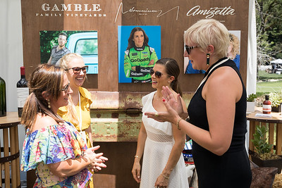 Dannica Patrick standing in front of her live lot display - Auction Napa Valley Live Celebration