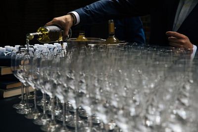 Guests greeted with splash of Napa Valley wine at the 2018 Auction Napa Valley Many Bottle Vintner Kick-Off Celebration.  Photo by Alexander Rubin for Napa Valley Vintners