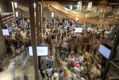 Charles Krug barrel room is packed with Auction Napa Valley bidders