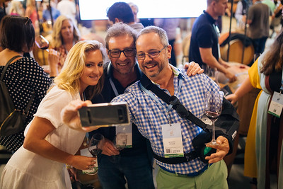 Guests taking a selfie with winemaker Philippe Melka at the 2019 Napa Valley Barrel Auction