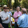Dan Michael (L) and Hugh Davies (R) chat with lead auctioneer Fritz Hatton (back to camera).