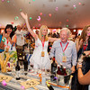 """Celebrating the winning bid of lot number 1 at Auciton Napa Valley 2014. Photo by <a href=""""http://www.tinacciphoto.com"""" target=""""_blank"""">Jason Tinacci</a> for the Napa Valley Vintners."""