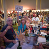 """Paddle 425 bids on a lot.  Photo by <a href=""""http://napasphotographer.com/"""">Bob McClenahan</a> for Napa Valley Vintners."""