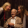 """Auction Napa Valley co-chairs Kary Duncan and Valerie Gargiulo sneak in to give Peter Mondavi Sr. a peck on the cheek. Photo by <a href=""""http://www.tinacciphoto.com"""" target=""""_blank"""">Jason Tinacci</a> for the Napa Valley Vintners."""