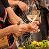 """A guest shows the proper form for tasting fine caviar and sparkling wine. Photo by <a href=""""http://www.tinacciphoto.com"""" target=""""_blank"""">Jason Tinacci</a> for the Napa Valley Vintners."""