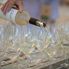 """Charles Krug wines are poured for arriving guests at the barrel auction.  Photo by <a href=""""http://napasphotographer.com/"""">Bob McClenahan</a> for Napa Valley Vintners."""
