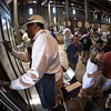 """Bidding has begun at the barrel auction.  Photo by <a href=""""http://napasphotographer.com/"""">Bob McClenahan</a> for Napa Valley Vintners."""