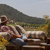 """A guest takes a moment to savor delicious Napa Valley wine and the vineyards where it came from. Photo by <a href=""""http://www.tinacciphoto.com"""" target=""""_blank"""">Jason Tinacci</a> for the Napa Valley Vintners."""