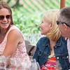 """Co-Chairs David and Kary Duncan share a laugh with a guest at Gargiulo Vineyards. Photo by <a href=""""http://www.tinacciphoto.com"""" target=""""_blank"""">Jason Tinacci</a> for the Napa Valley Vintners."""
