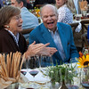 """Long time friends Mary Novak and Raymond Duncan share a hearty laugh at the Top Bidder Dinner. Photo by <a href=""""http://www.tinacciphoto.com"""" target=""""_blank"""">Jason Tinacci</a> for the Napa Valley Vintners."""