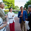 """2013 Auction Napa Valley Chair Garen Staglin plays sommellier with guests at the Top Bidder Dinner. Photo by <a href=""""http://www.tinacciphoto.com"""" target=""""_blank"""">Jason Tinacci</a> for the Napa Valley Vintners."""