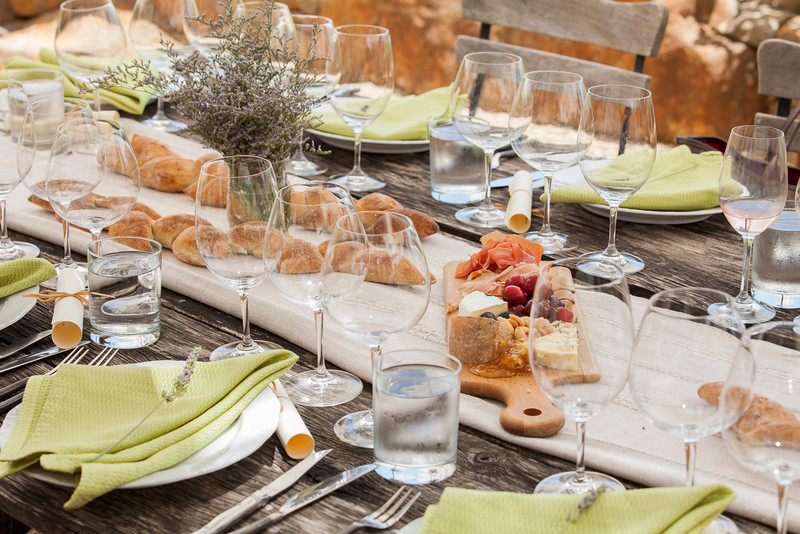 """Guests enjoyed a family-style meal prepared by famed Dry Creek Kitchen. Photo by <a href=""""http://www.tinacciphoto.com"""" target=""""_blank"""">Jason Tinacci</a> for the Napa Valley Vintners."""
