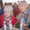 "Margrit Mondavi and Molly Chappellet talking with bidders during Auction Napa Valley 2015 at Meadowood Napa Valley. <br> <br> Photo by <a href=""http://napasphotographer.com/"">Bob McClenahan</a>"