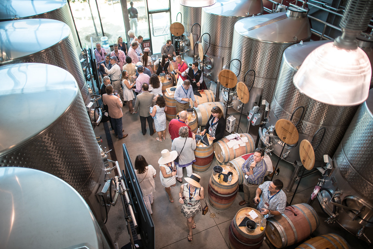 """Just a few of the many wines being sampled during the barrel auction. <br> <br> Photo by <a href=""""http://napasphotographer.com/"""">Bob McClenahan</a>"""