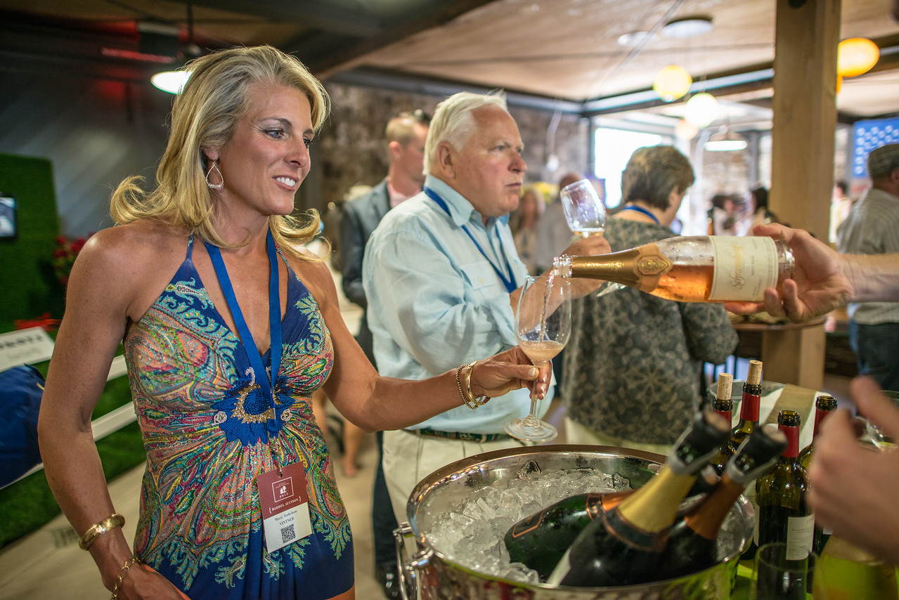 """Guests are able to sample some of Schramberg's wines at the barrel auction, <br> <br> Photo by <a href=""""http://napasphotographer.com/"""">Bob McClenahan</a>"""