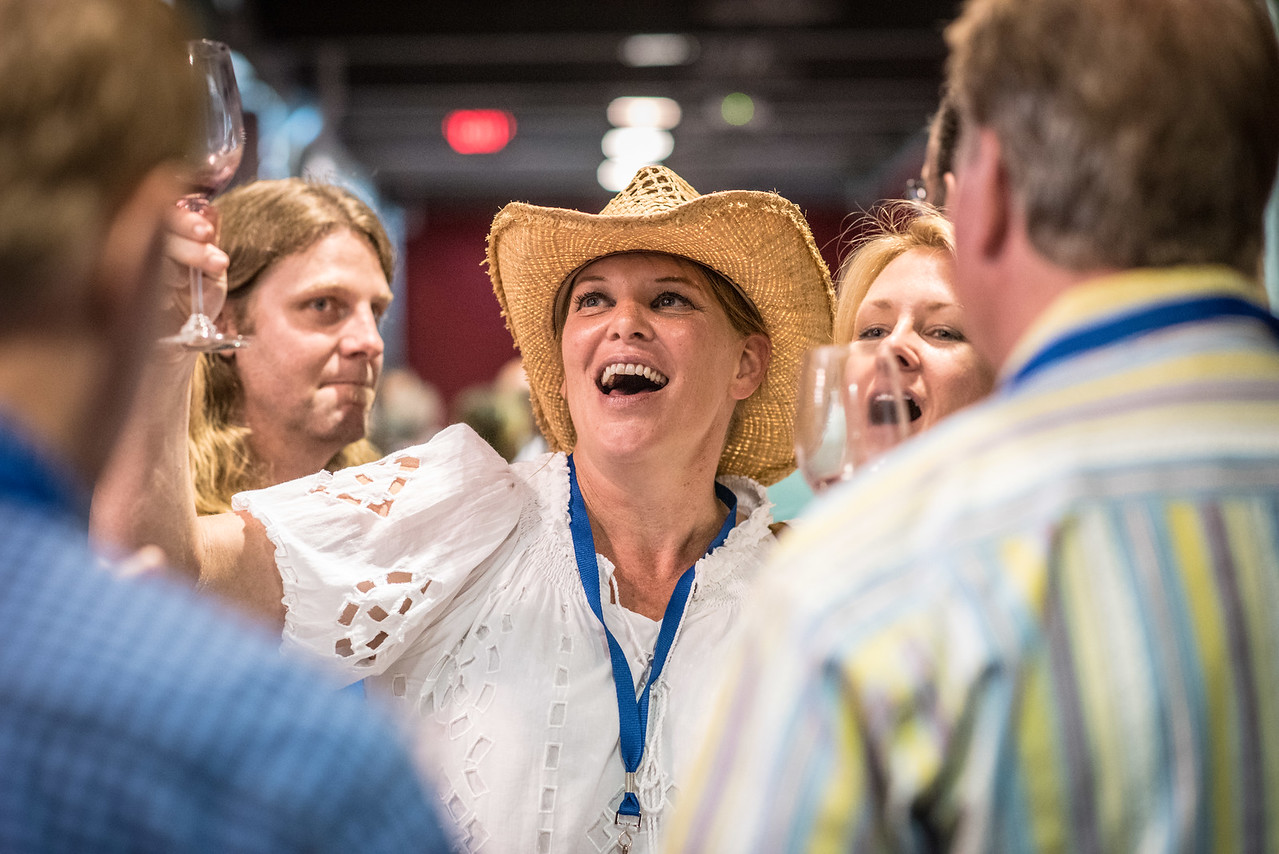 """Guests having a good time during the barrel auction. <br> <br> Photo by <a href=""""http://napasphotographer.com/"""">Bob McClenahan</a>"""