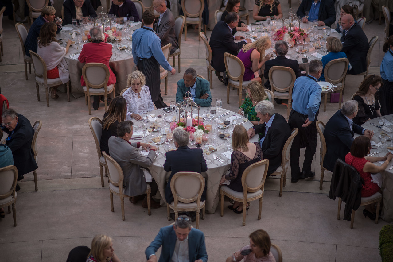 """Guests dined outside in the courtyard at Opus One. <br> <br> Photo by <a href=""""http://napasphotographer.com/"""">Bob McClenahan</a>"""