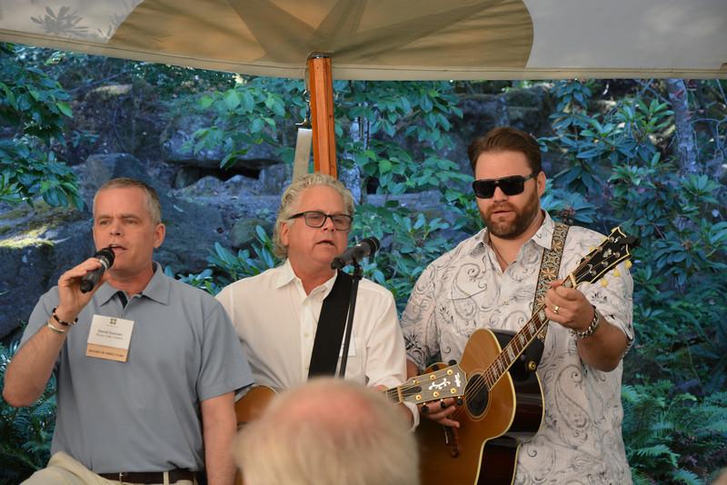 """David Duncan (L), Jeff Gargiulo (C) and James Otto (R) singing """"Sweet Home Napa Valley"""" at the vintner kickoff party."""