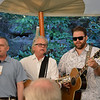 "David Duncan (L), Jeff Gargiulo (C) and James Otto (R) singing ""Sweet Home Napa Valley"" at the vintner kickoff party."