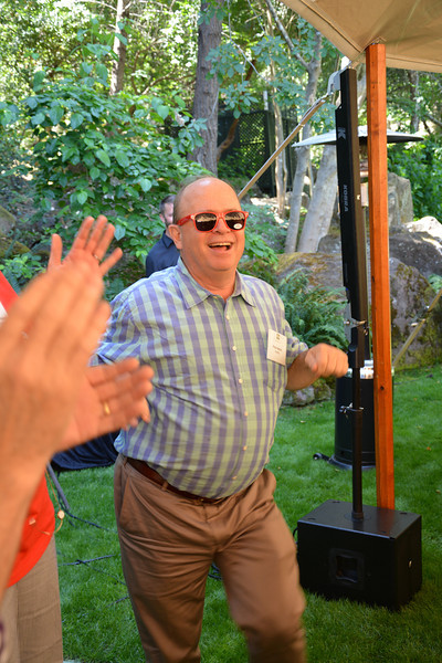 """Lead auctioneer and vintner Fritz Hatton getting his """"Happy"""" on for Saturday."""