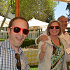 "Vintners show off their ""Happy"" sunglasses."