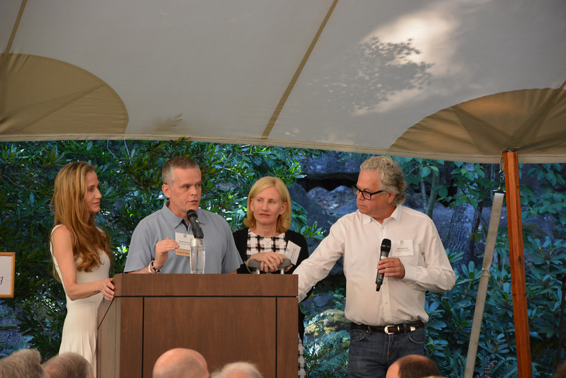 Honorary Auction chairs, the Duncans and the Gargiulos, report to the membership at the vintner kickoff party.