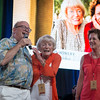 "Margrit Mondavi and Geneviève Janssens go on stage with Fritz Hatton to promote their lot.  Photo by <a href=""http://napasphotographer.com/"">Bob McClenahan</a> for Napa Valley Vintners."