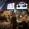 """Paddle 19 is raised in hopes of winning.  Photo by <a href=""""http://napasphotographer.com/"""">Bob McClenahan</a> for Napa Valley Vintners."""