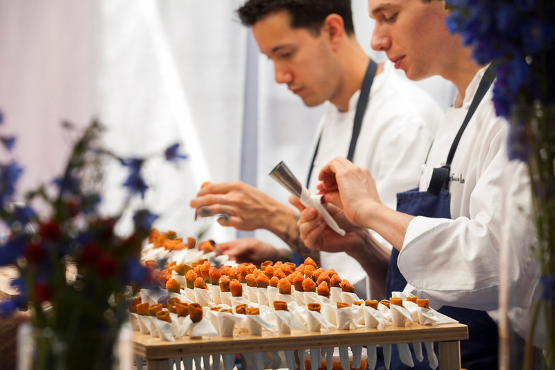 "Zen and the art of rolling coronets - a French Laundry classic served at the Saturday Auction lunch. Photo by <a href=""http://www.tinacciphoto.com"" target=""_blank"">Jason Tinacci</a> for the Napa Valley Vintners."
