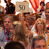 "Paddle 50 bidding. Photo by <a href=""http://www.tinacciphoto.com"" target=""_blank"">Jason Tinacci</a> for the Napa Valley Vintners."
