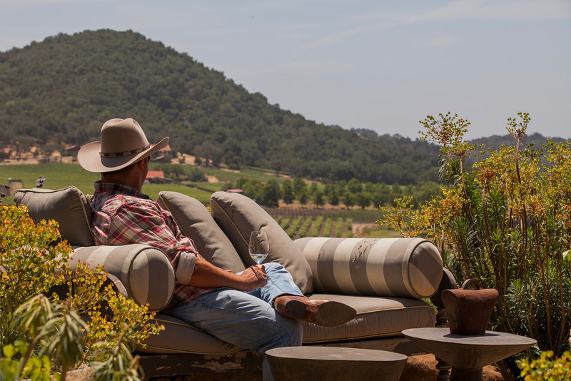 "A guest takes a moment to savor delicious Napa Valley wine and the vineyards where it came from. Photo by <a href=""http://www.tinacciphoto.com"" target=""_blank"">Jason Tinacci</a> for the Napa Valley Vintners."