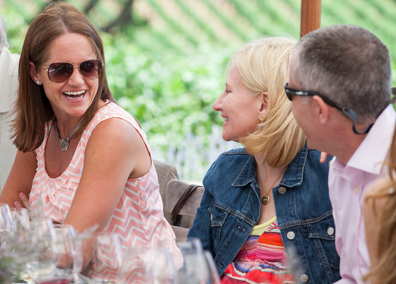 "Co-Chairs David and Kary Duncan share a laugh with a guest at Gargiulo Vineyards. Photo by <a href=""http://www.tinacciphoto.com"" target=""_blank"">Jason Tinacci</a> for the Napa Valley Vintners."
