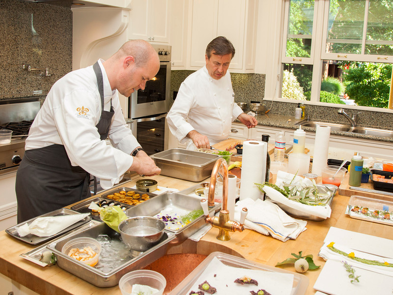 "Chefs Daniel Boulu and Michael Tusk preparing an opulent meal for Auction Napa Valley guests. Photo by <a href=""http://www.tinacciphoto.com"" target=""_blank"">Jason Tinacci</a> for the Napa Valley Vintners."