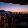 "Guests sip wines while taking in the sunset at Cardinale.  Photo by <a href=""http://napasphotographer.com/"">Bob McClenahan</a> for Napa Valley Vintners."