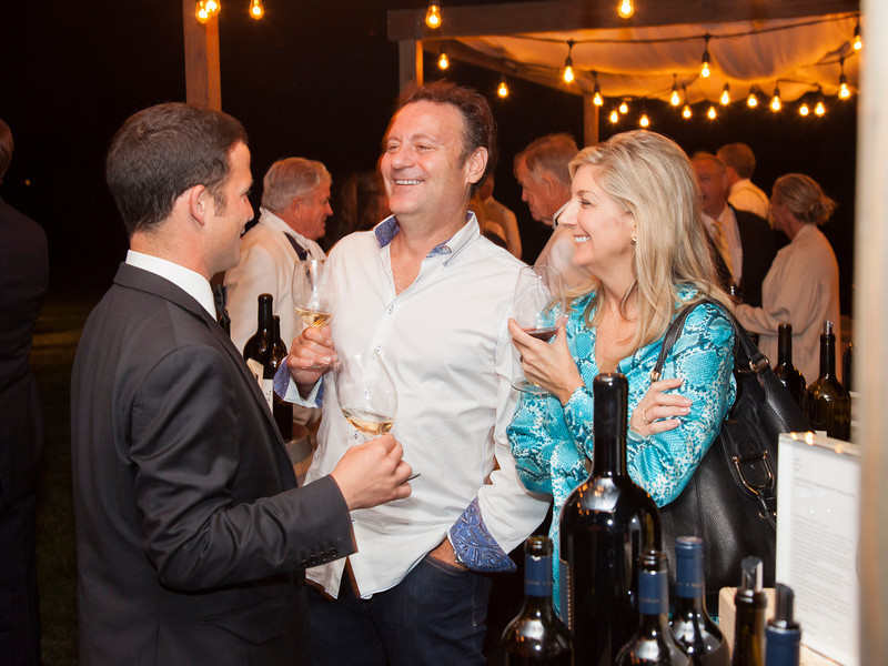 """Guests chat with one of the seven vintner members pouring wine at the Alpha Omega private party. Photo by <a href=""""http://www.tinacciphoto.com"""" target=""""_blank"""">Jason Tinacci</a> for the Napa Valley Vintners."""