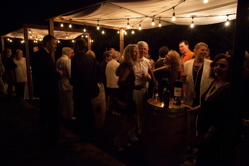 """Guests mingled in the speakeasy with seven vintner members showcasing their live auction lots. Photo by <a href=""""http://www.tinacciphoto.com"""" target=""""_blank"""">Jason Tinacci</a> for the Napa Valley Vintners."""